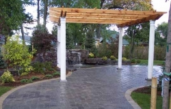 Sealed interlock back patio with pergola and waterfall.jpg